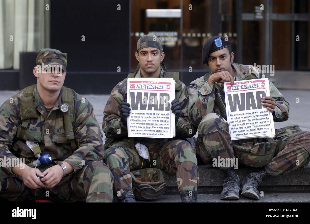 US Soldiers Reading Newspaper Headline Of WAR Three Days After 9 11 Terrorist Attacks In New