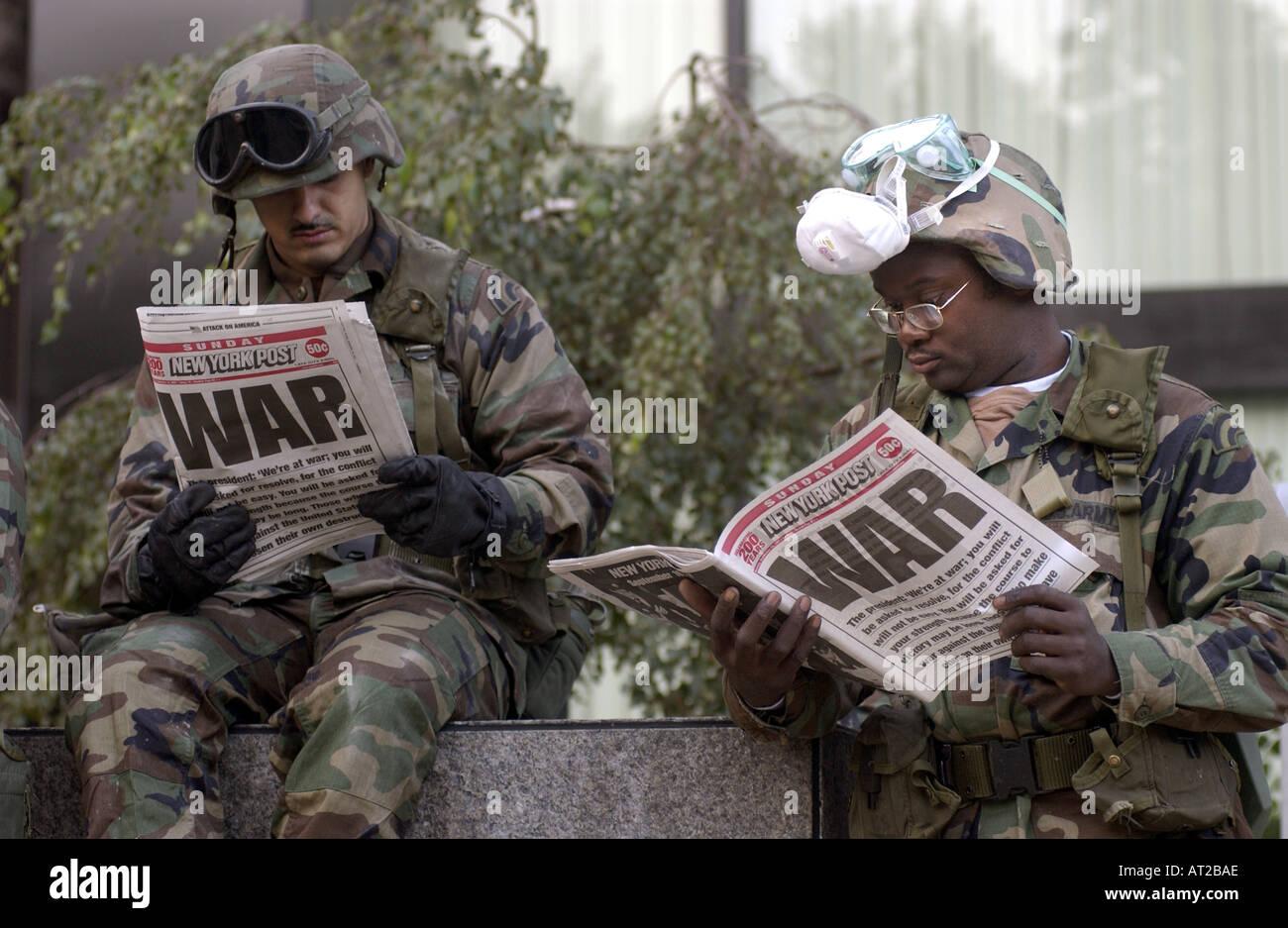 US Soldiers reading newspaper headline of WAR three days after 9 11  terrorist attacks in New York City at ground zero - Stock Image