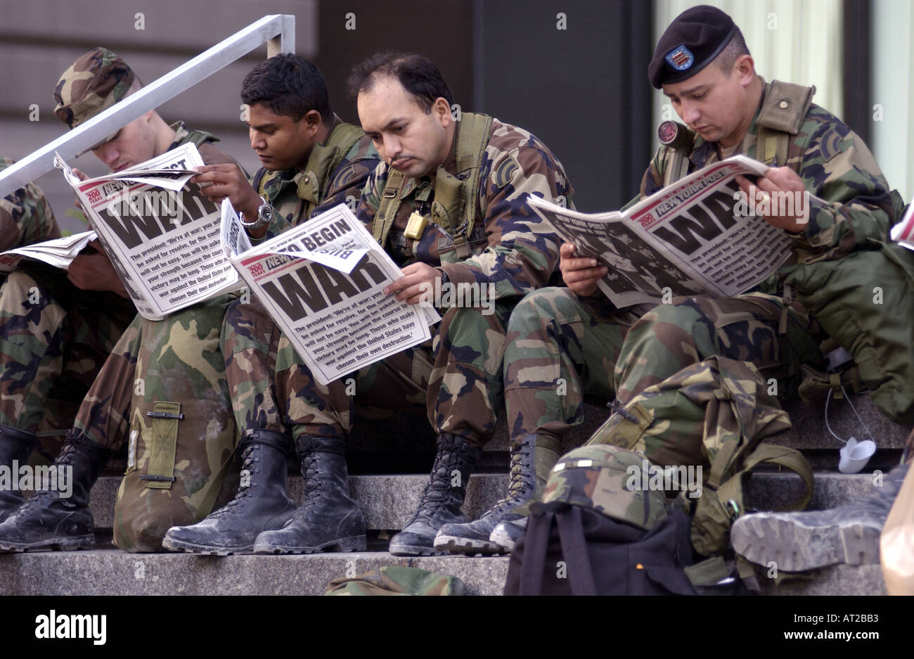 US Soldiers reading newspaper headline of WAR three days after 9 11 at  GROUND ZERO - Stock Image