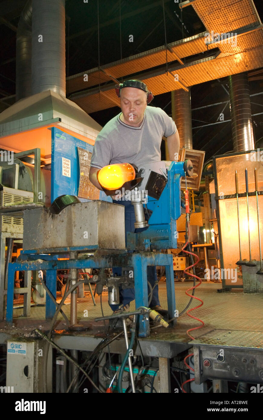 Ireland County Waterford Waterford Crystal factory guided tour glass blower forming vase - Stock Image