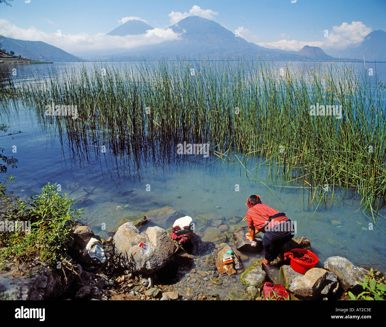 Lake Atitlan Solola Department Guatemala Mayan Indian woman washing clothes in lake - Stock Image