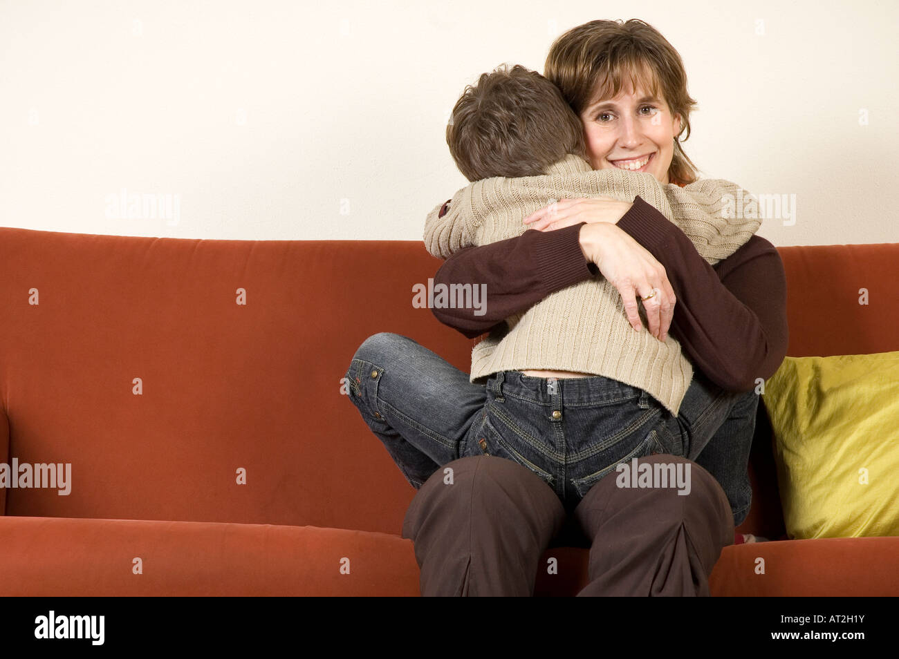 Mother holding her son - Stock Image