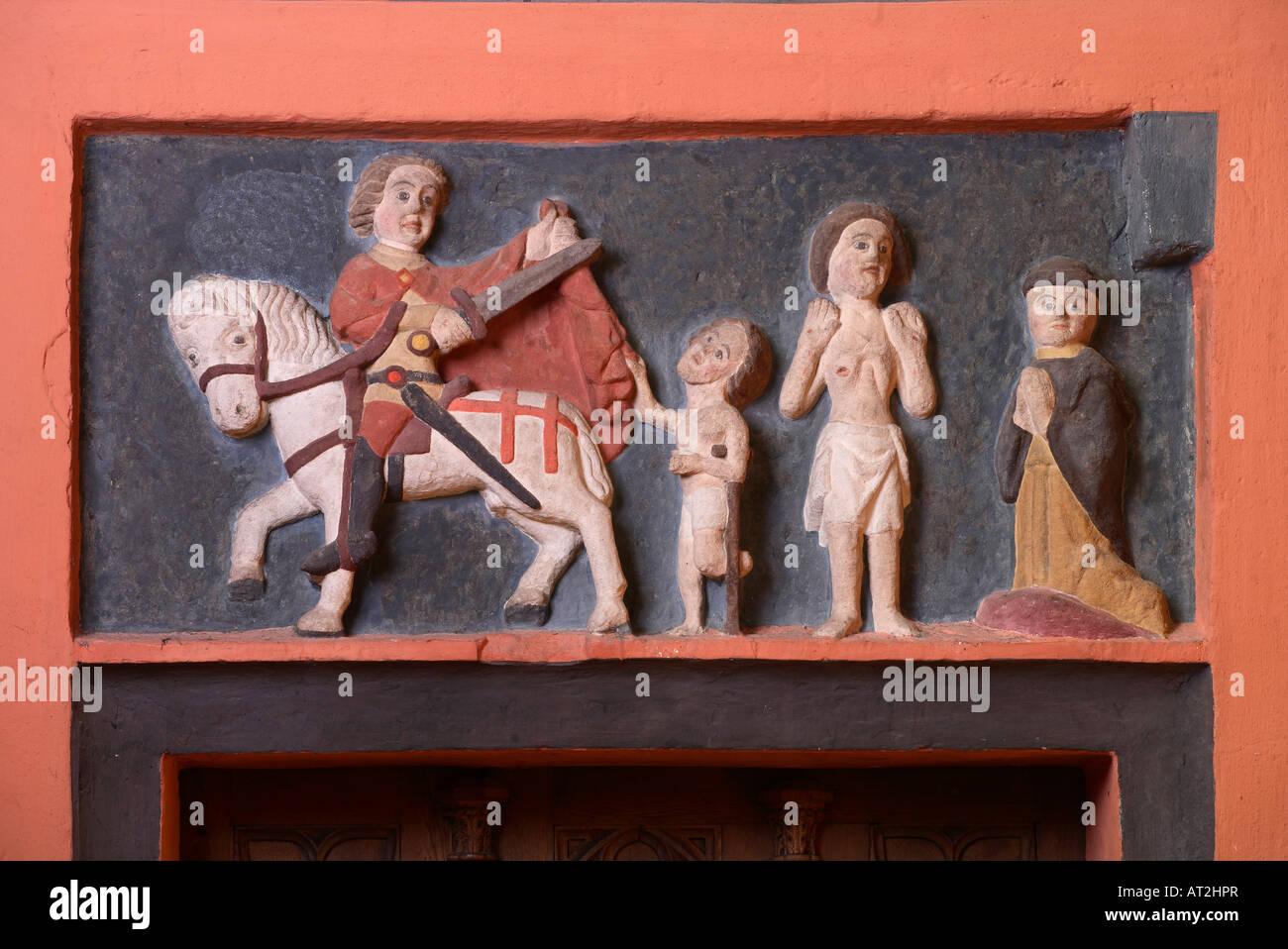 St. Wendel Basilika St. Wendelin (Wendalinusbasilika) Spätromanisches Relief an der Turmostwand heiliger Martin - Stock Image