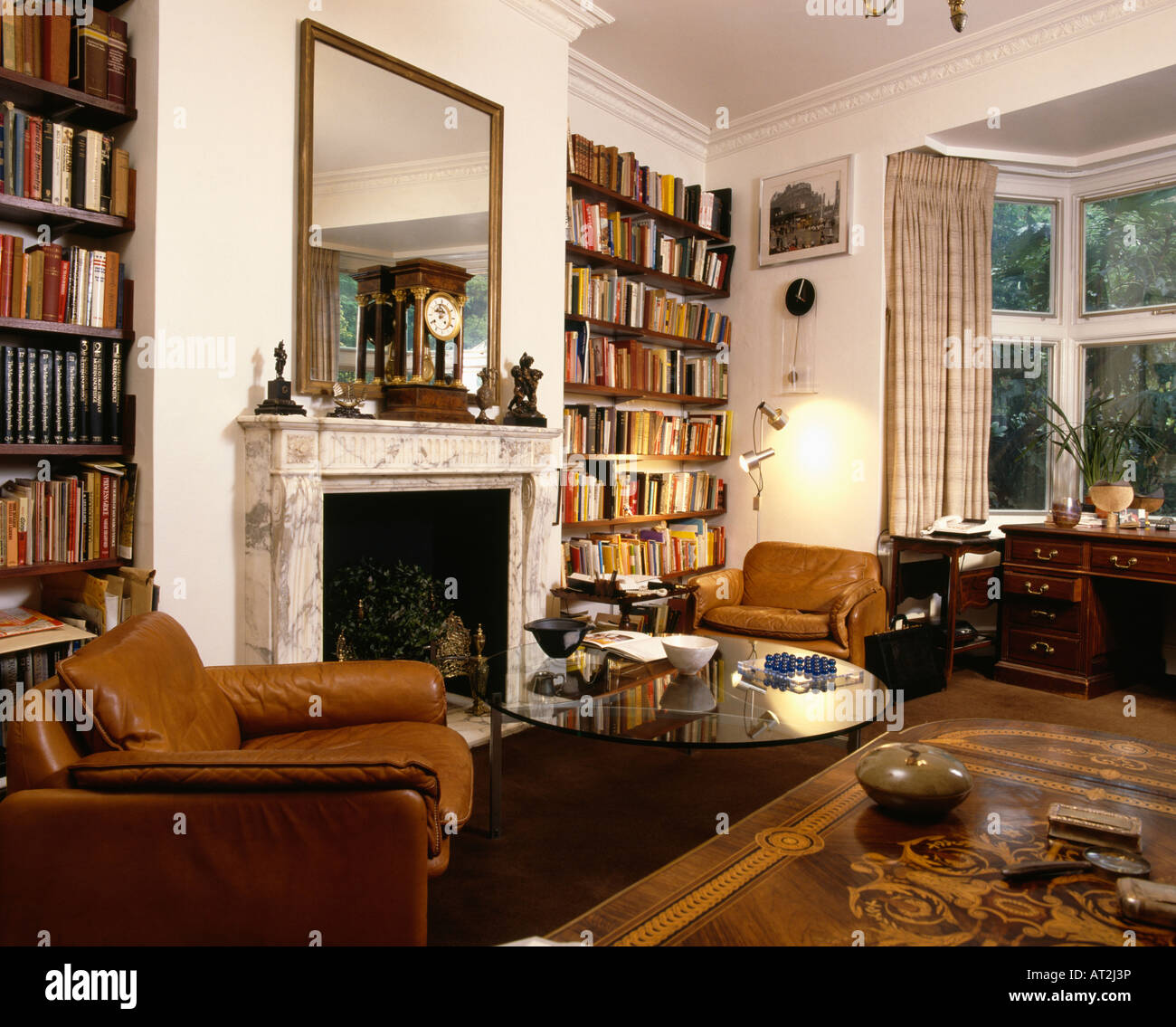 Brown Leather Armchairs In Seventies Living Room With Bookshelves And Stock Photo Alamy