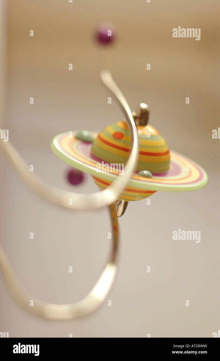 toy with saturn and moons shallow focus vertical - Stock Image