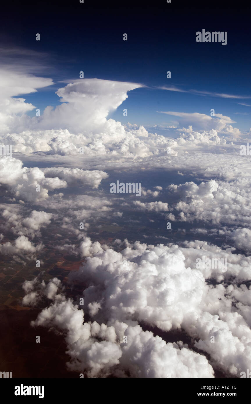 Picturesque aerial sea of high noon fluffy Clouds in a blue Sky with cool colors in a vertical technicolor view Stock Photo