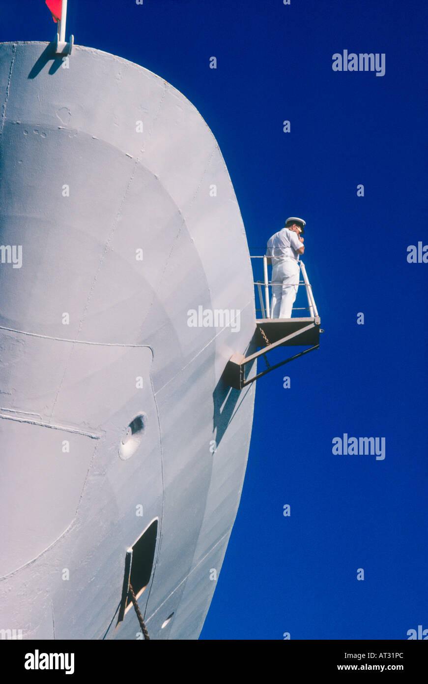 Crew member on QE2 cruise ship lookout platform - Stock Image