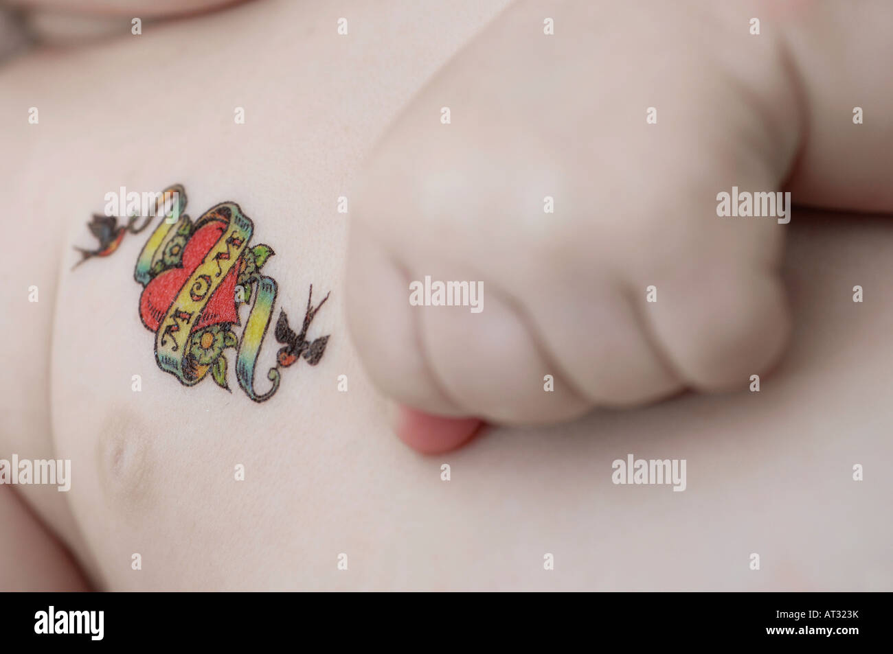 3 month old caucasian baby boy with tattoo Stock Photo: 16185606 - Alamy