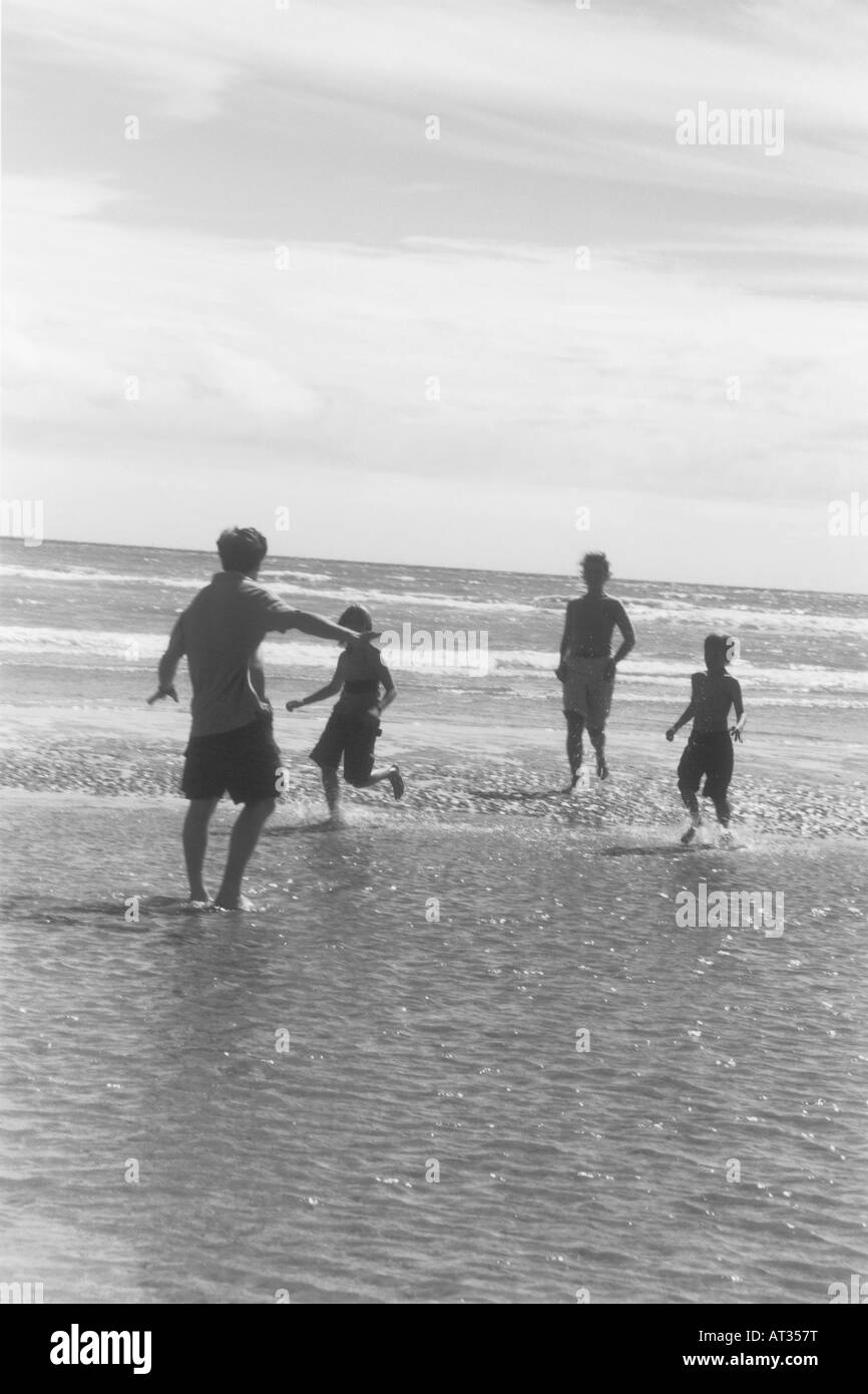 A family playing in the sea - Stock Image