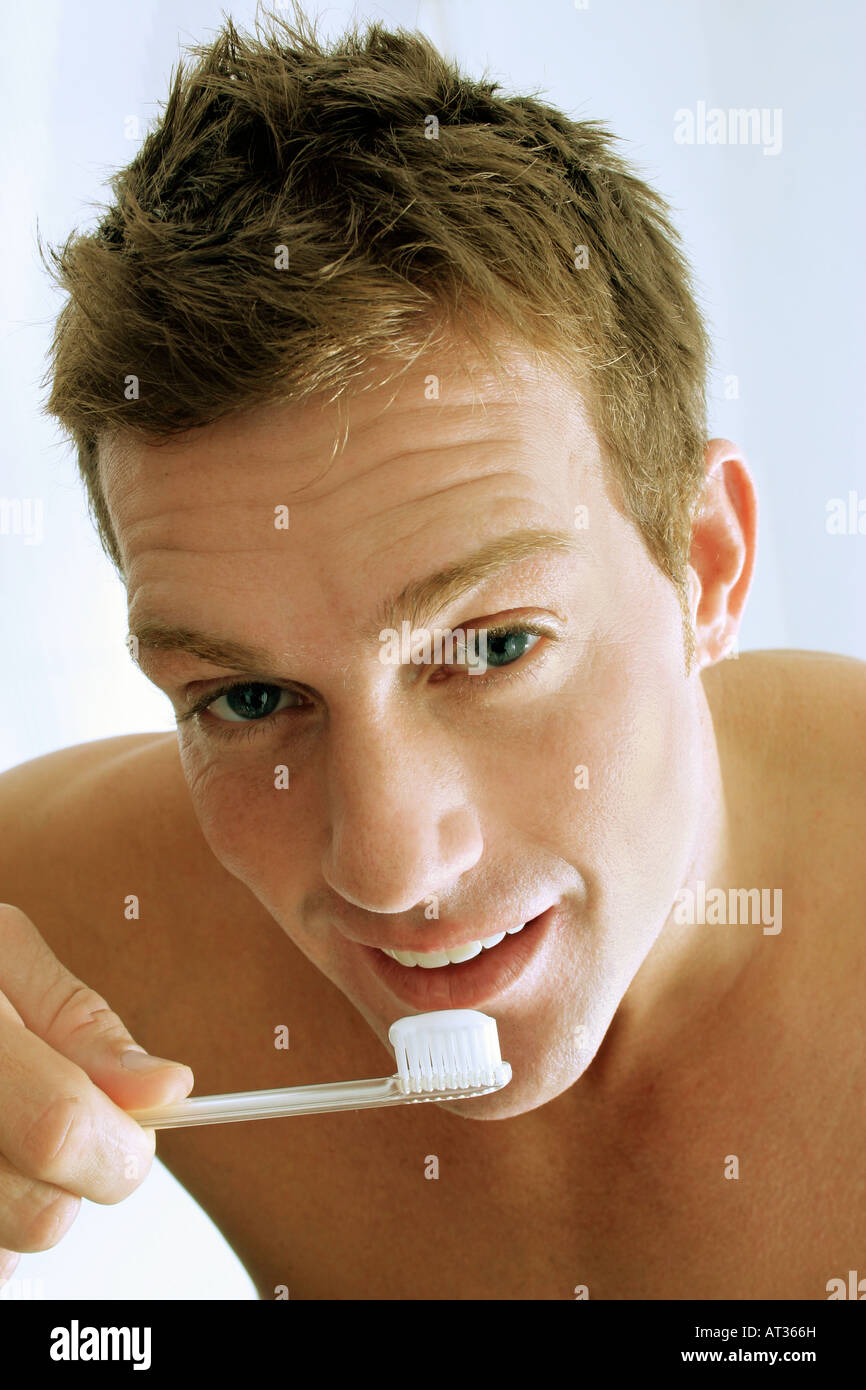 A man brushing his teeth - Stock Image