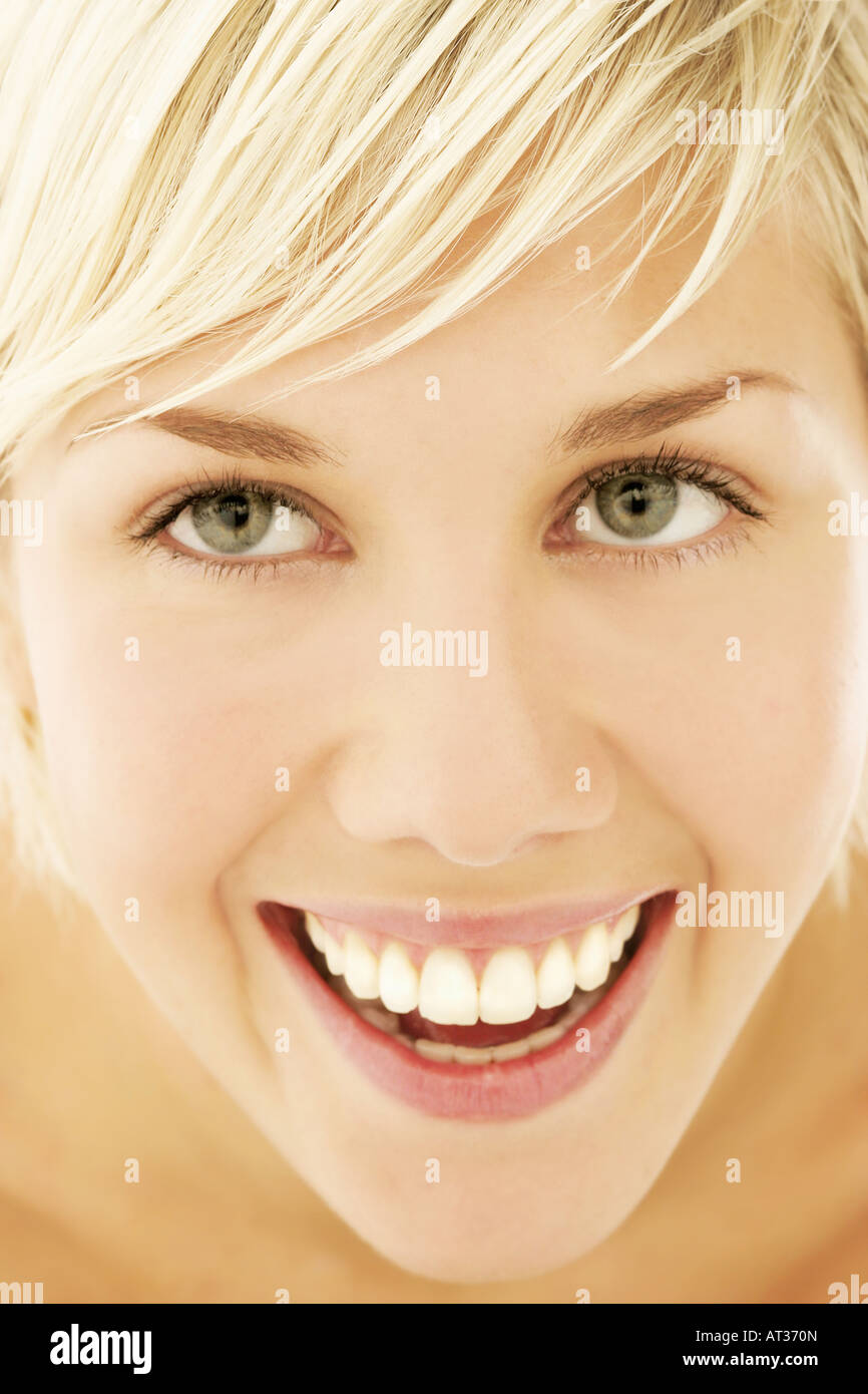 A woman smiling, close-up - Stock Image
