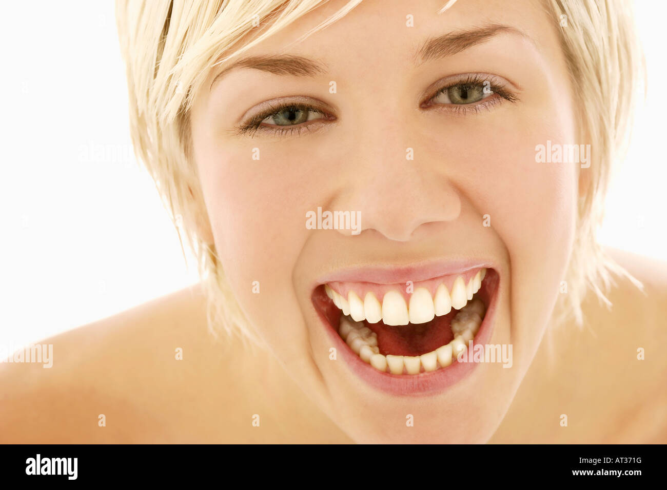 A portrait of young woman, laughing - Stock Image