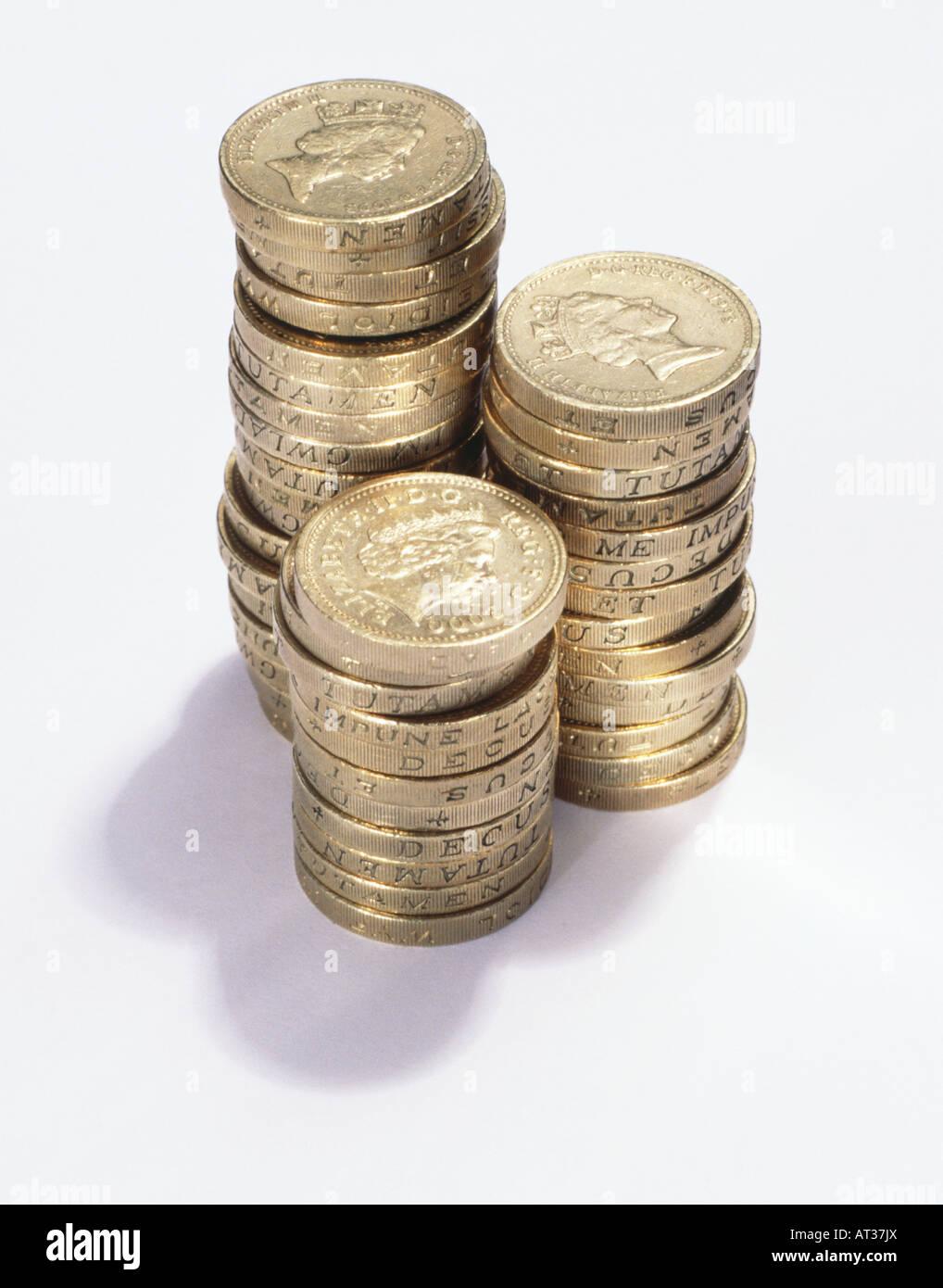 Three piles of pound coins - Stock Image