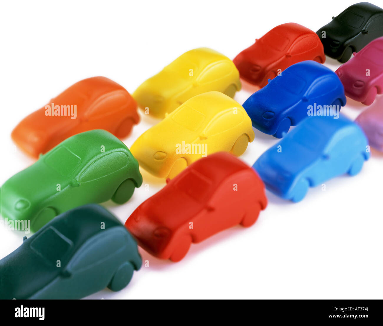 Model cars in a row, white background - Stock Image