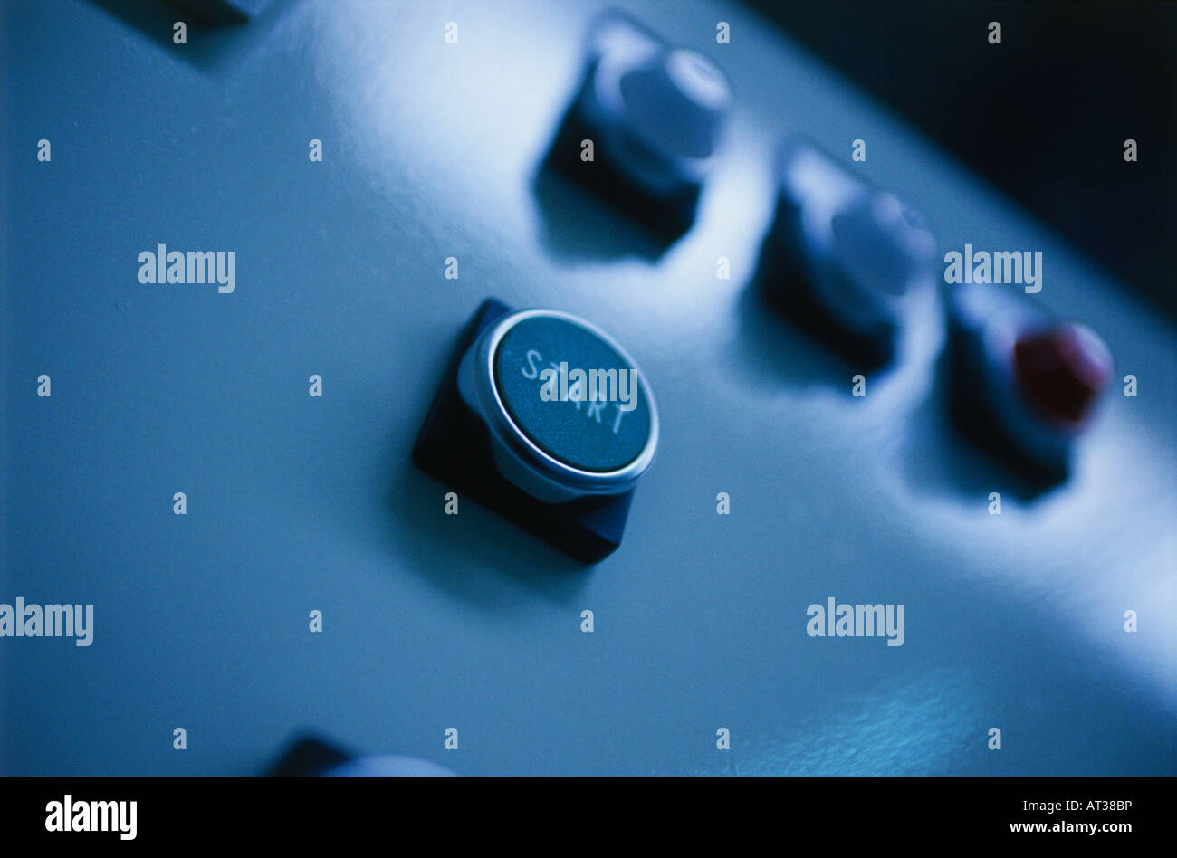A start button on a machine - Stock Image
