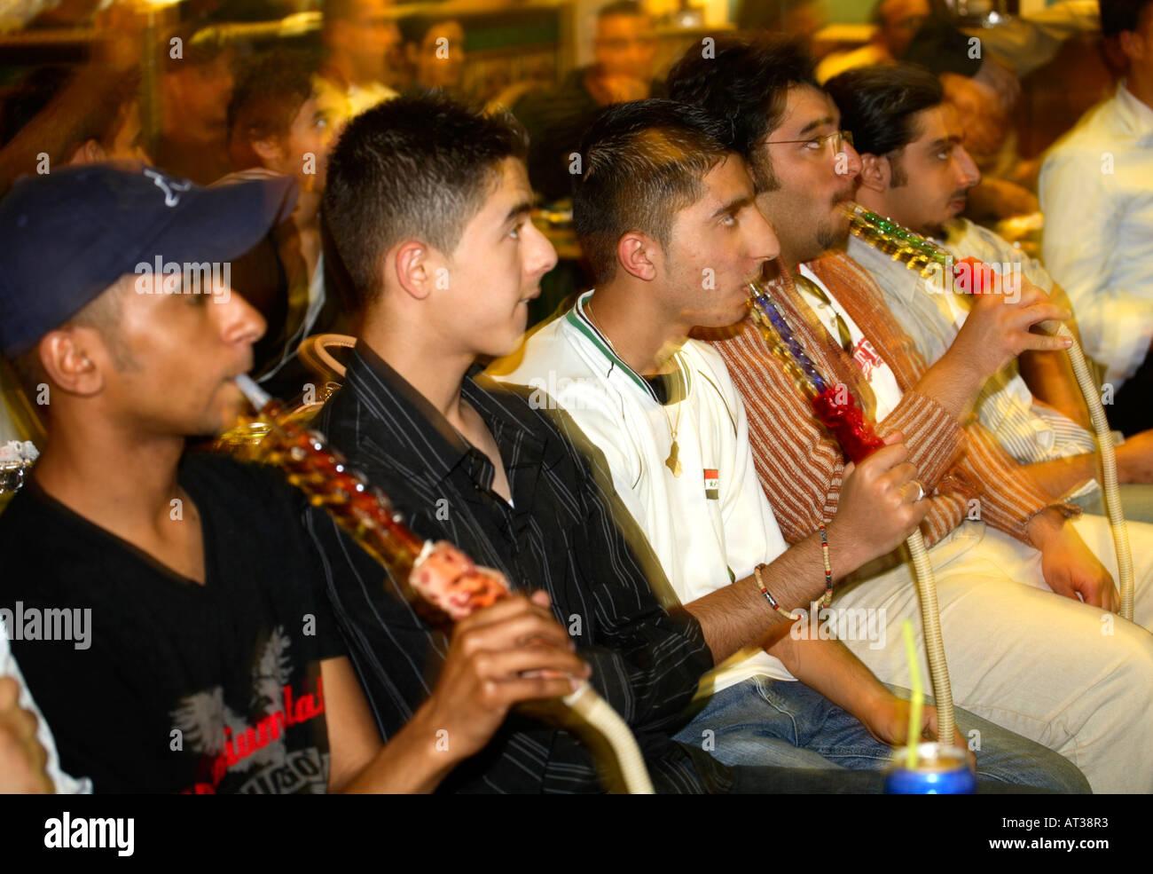 Saudi Arabian fans smoke shisha pipes watching their game vs