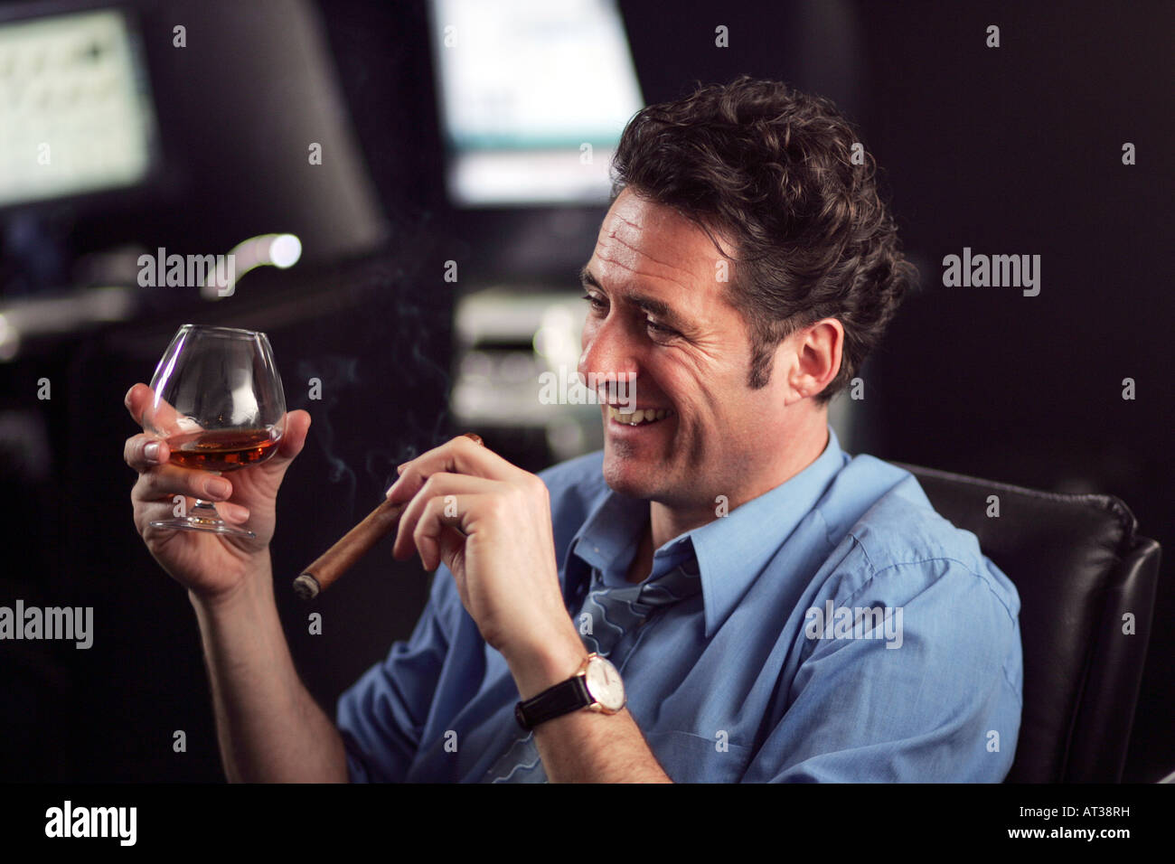 A Business Man Sitting At His Desk, Drinking Brandy And