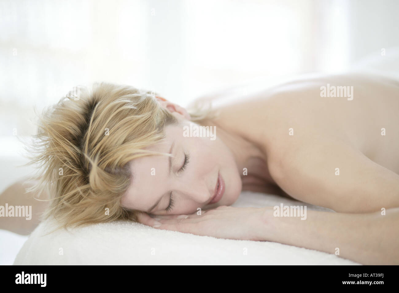 A woman in her forties relaxing at a beauty therapists Stock Photo