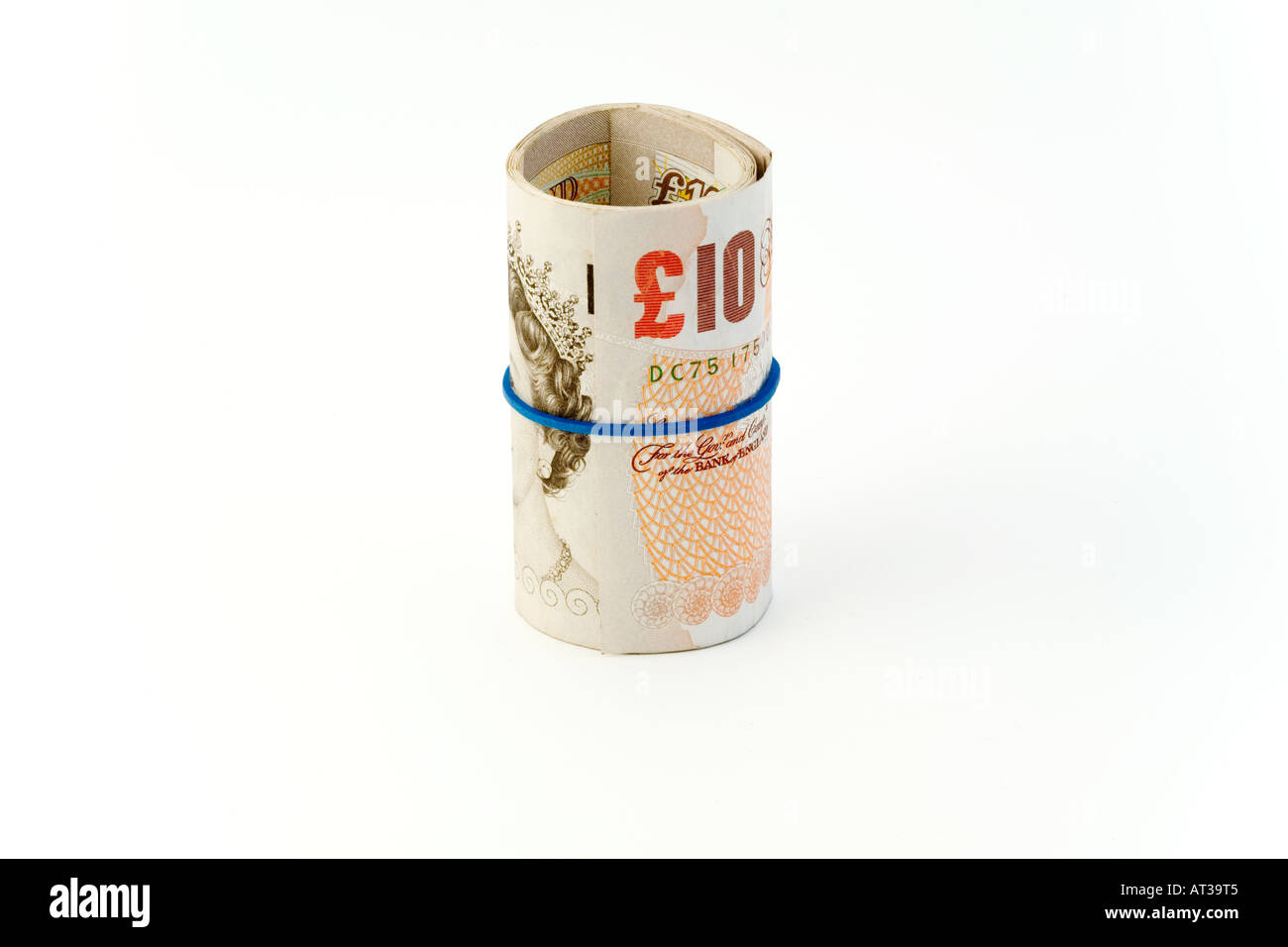 Roll of ten pound notes UK - Stock Image