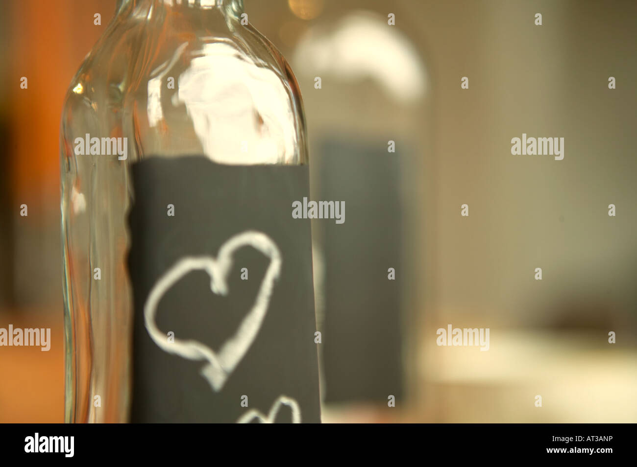 Heart shaped detail on a bottle, close-up - Stock Image