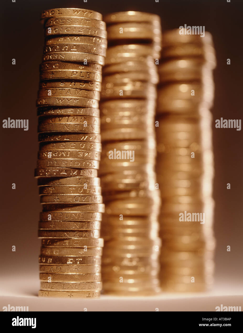 One pound coins stacked in three piles Stock Photo