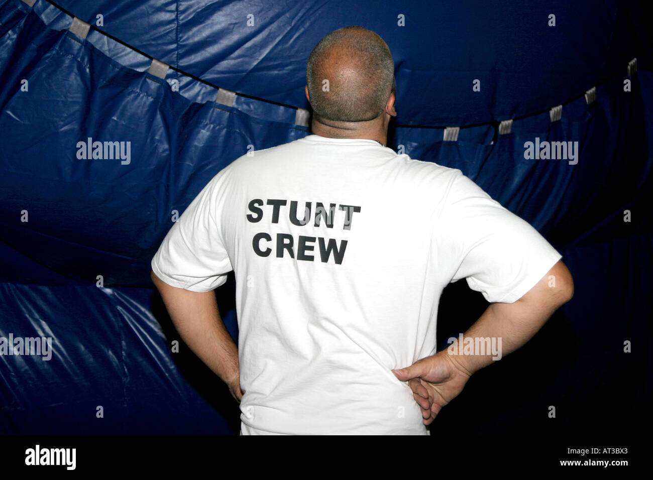A stunt crew member watching a stunt being staged - Stock Image