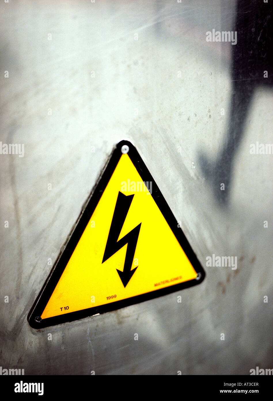 An electric warning sign - Stock Image