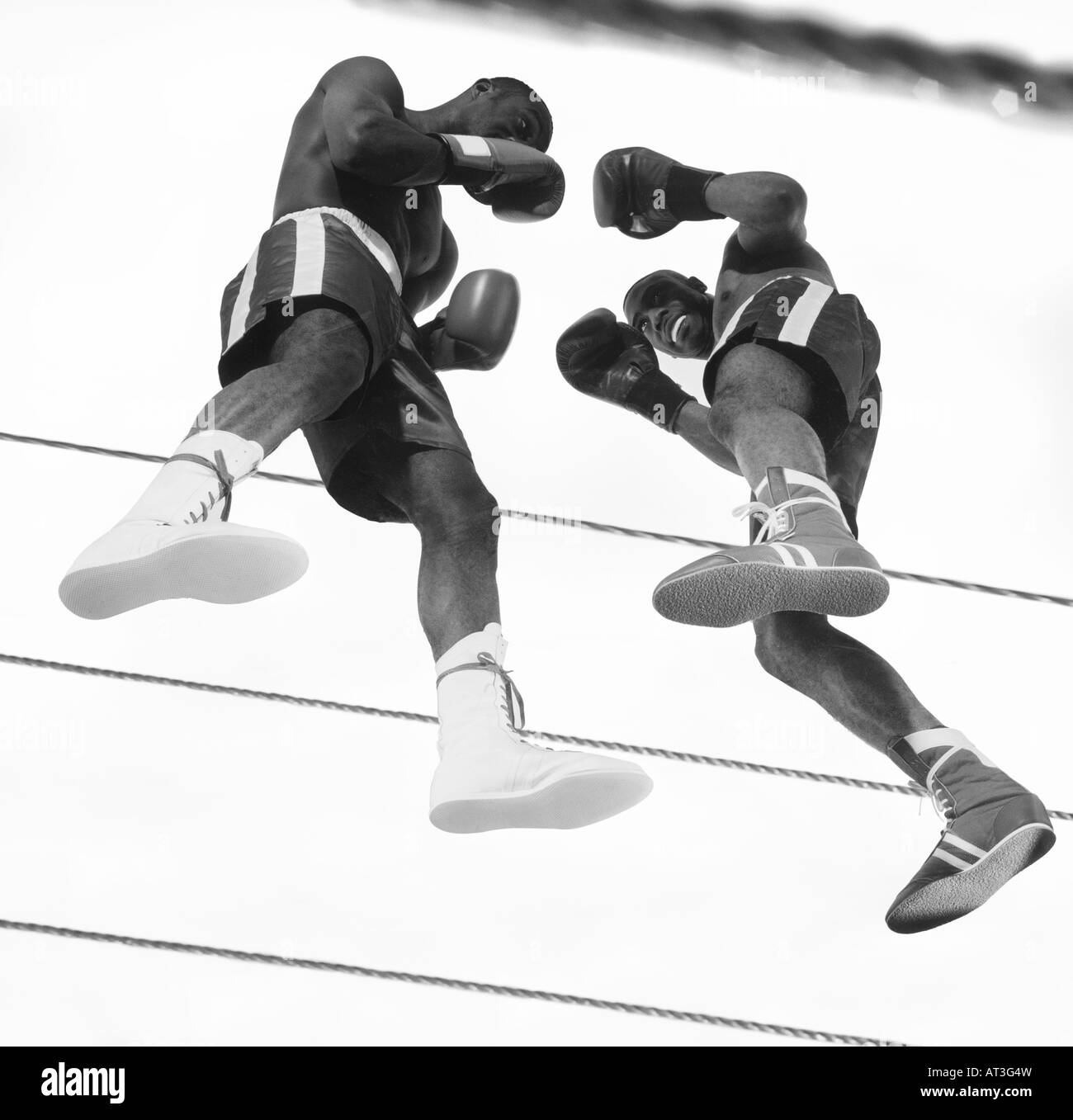 Two boxers fighting in a ring - Stock Image