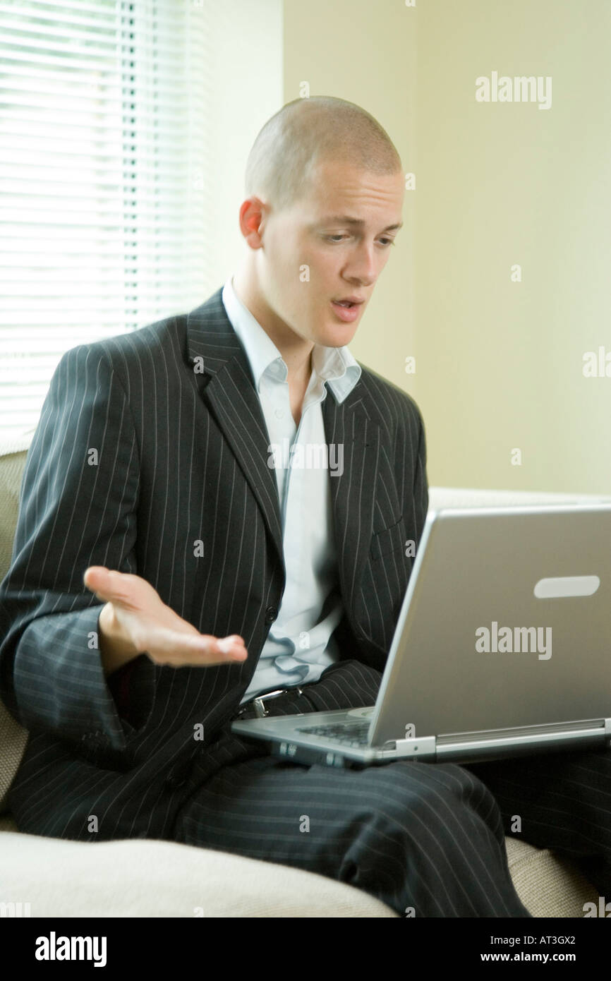 frustrated man with laptop computer - Stock Image