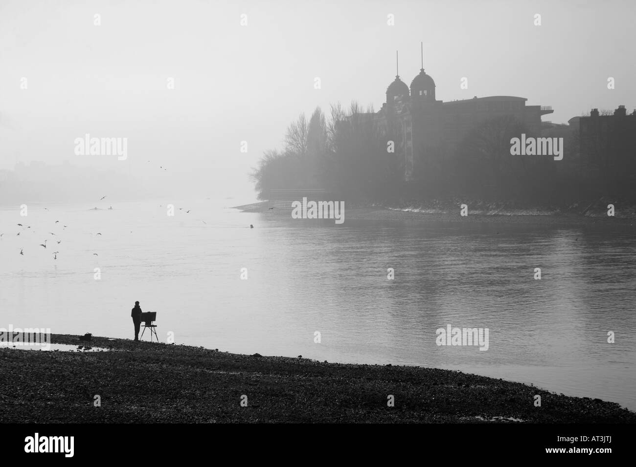 Artist painting the scene at the River Thames at Hammersmith, London - Stock Image