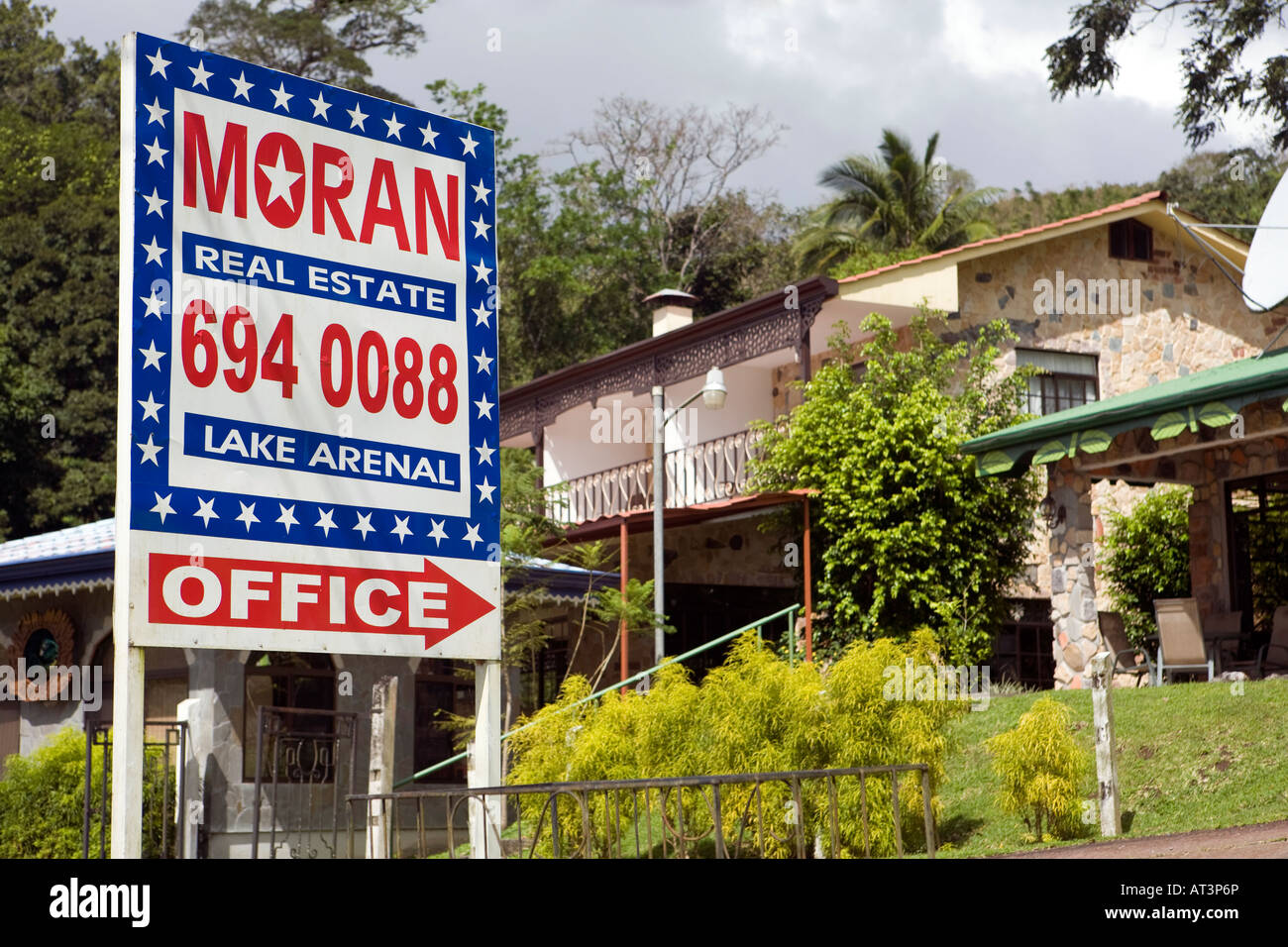 Costa Rica Laguna Arenal Real Estate agents sign outside lakeside property for sale - Stock Image