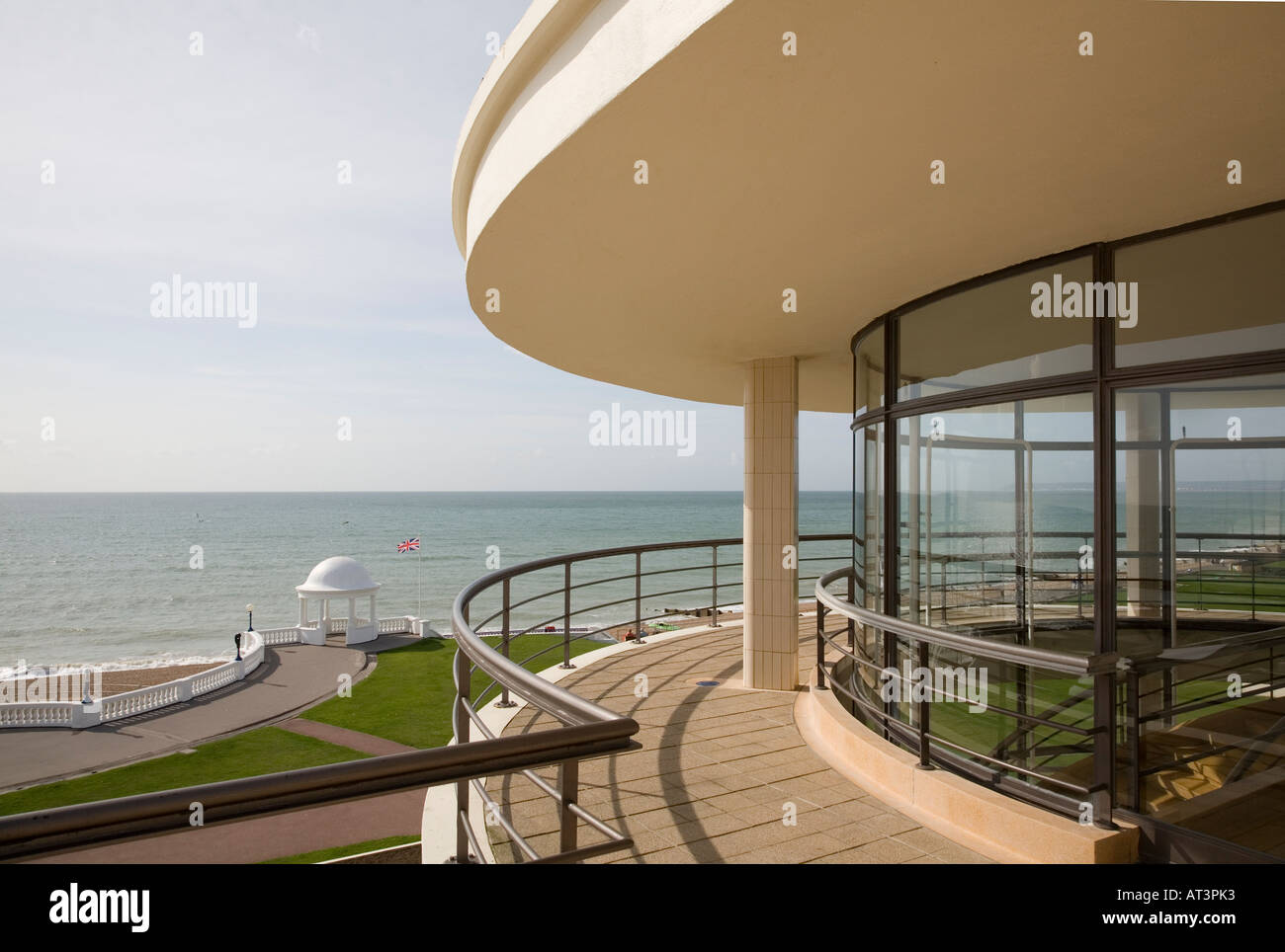 Exterior view from roof showing curved glazing and sea beyond - Stock Image