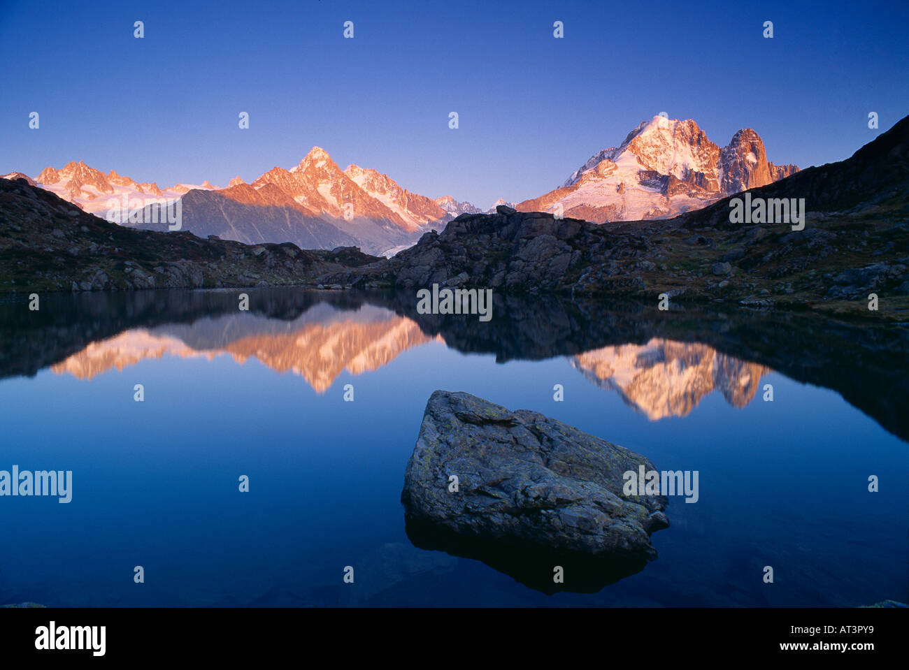 the Dru and Aiguille de Argentiere reflected in the Lac des Cheserys Massif du Mont Blanc nr Chamonix Savoie France Stock Photo