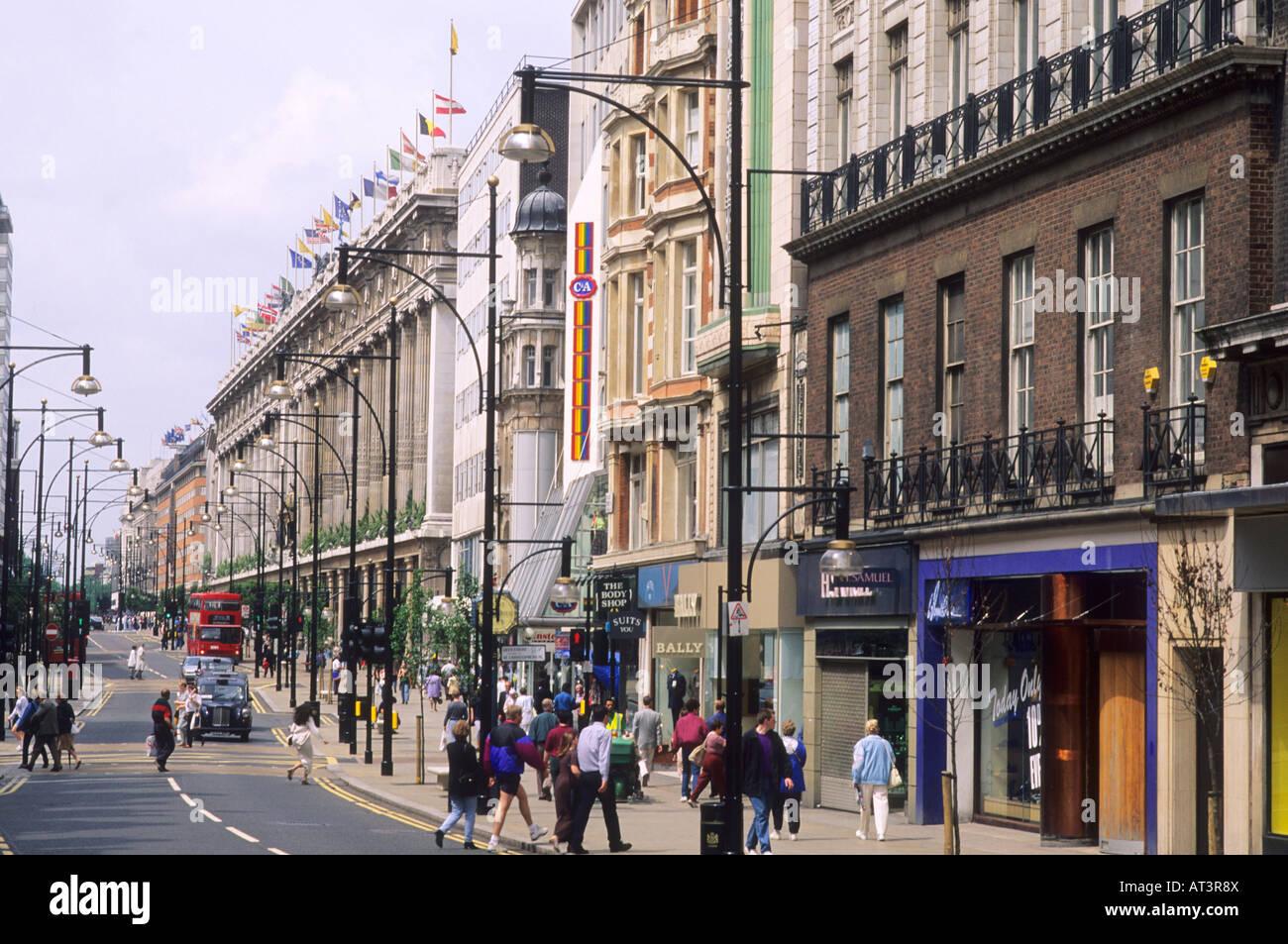 Oxford Street Selfridges London west end red bus England UK - Stock Image