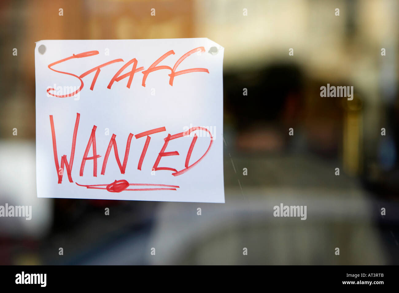 staff wanted hand written sign in restaurant window in Belfast city centre - Stock Image