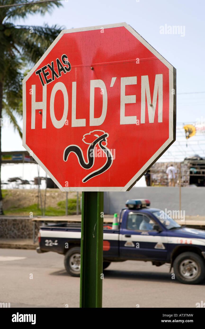 Costa Rica Quepos fake Texas hold em road sign advertising local casino - Stock Image