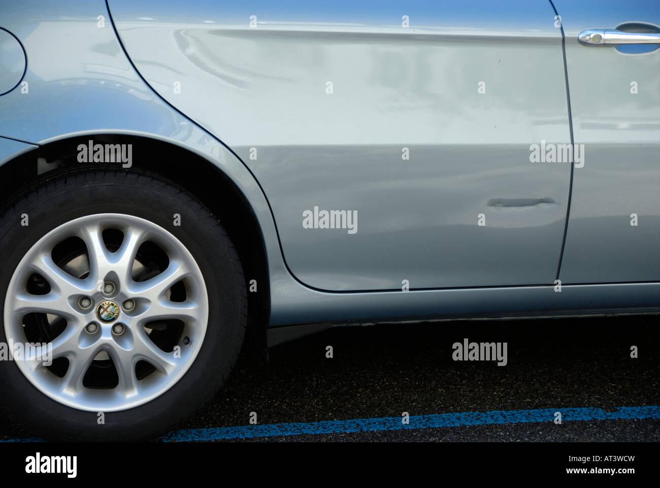 A scar on the door of a new car. - Stock Image