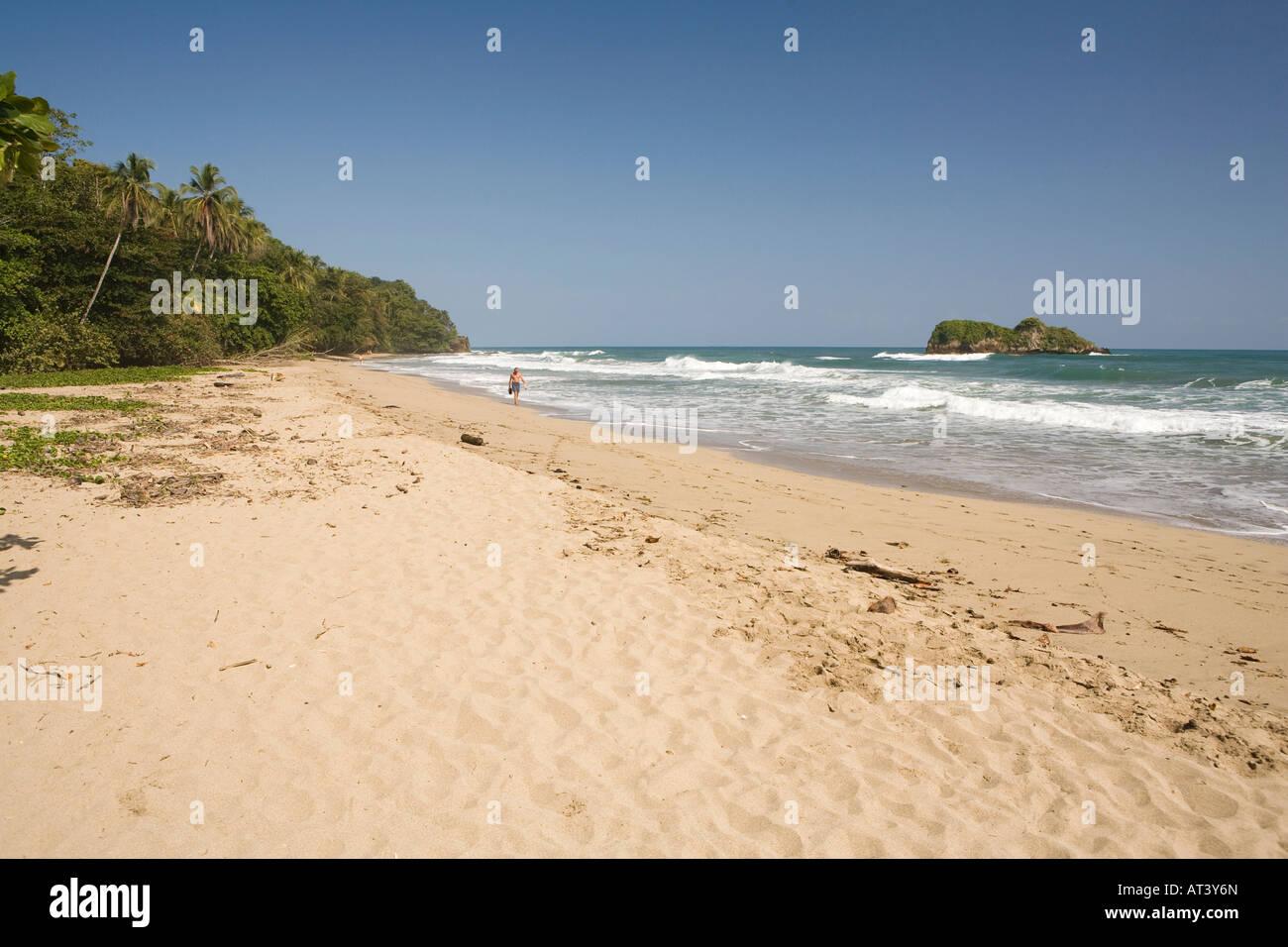 Costa Rica Caribbean Coast Puerto Viejo de Talamanca Cocles lone sunbather on soft sandy beach - Stock Image