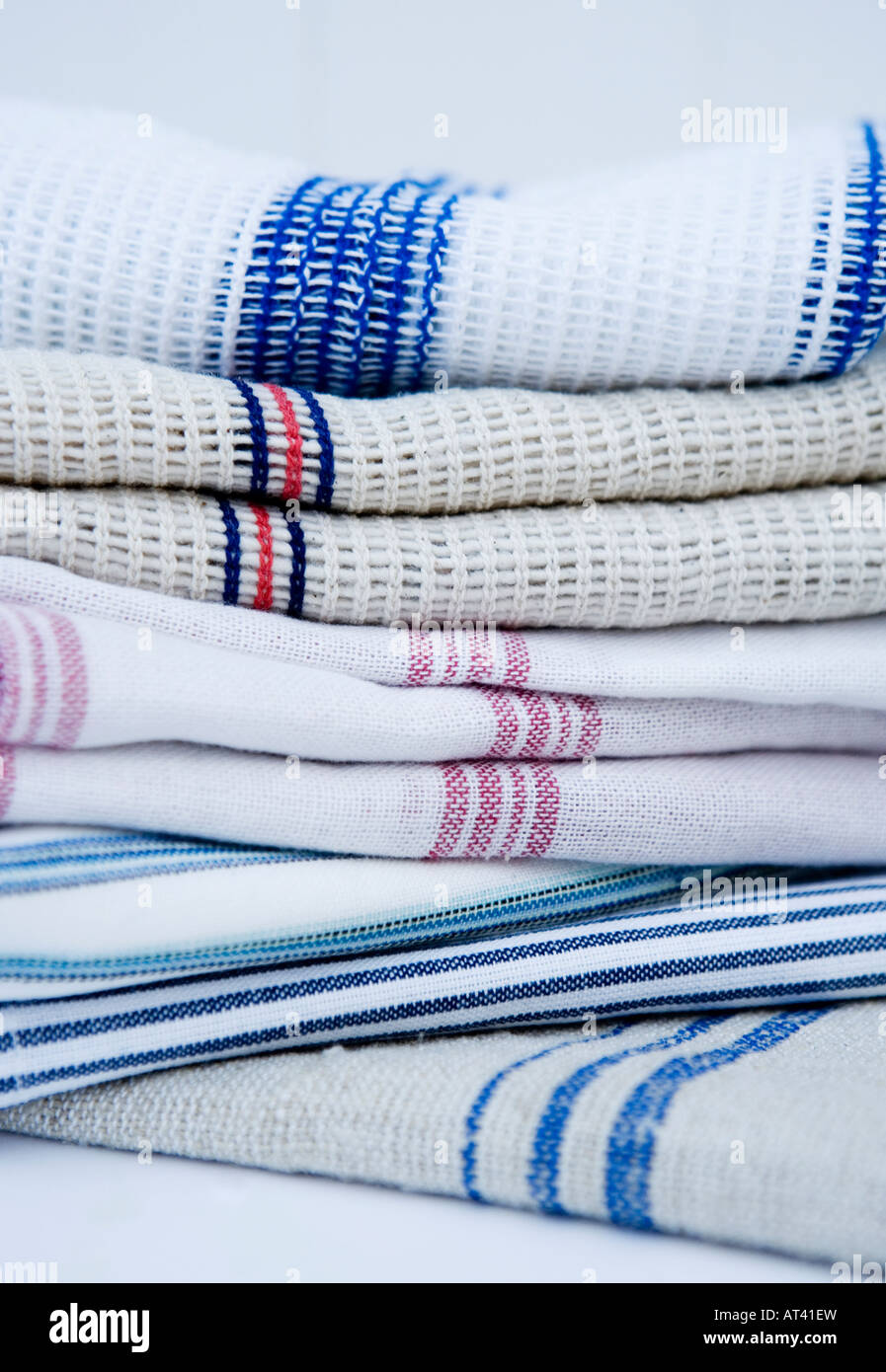 Linen washing up cloths and traditional tea towels - Stock Image