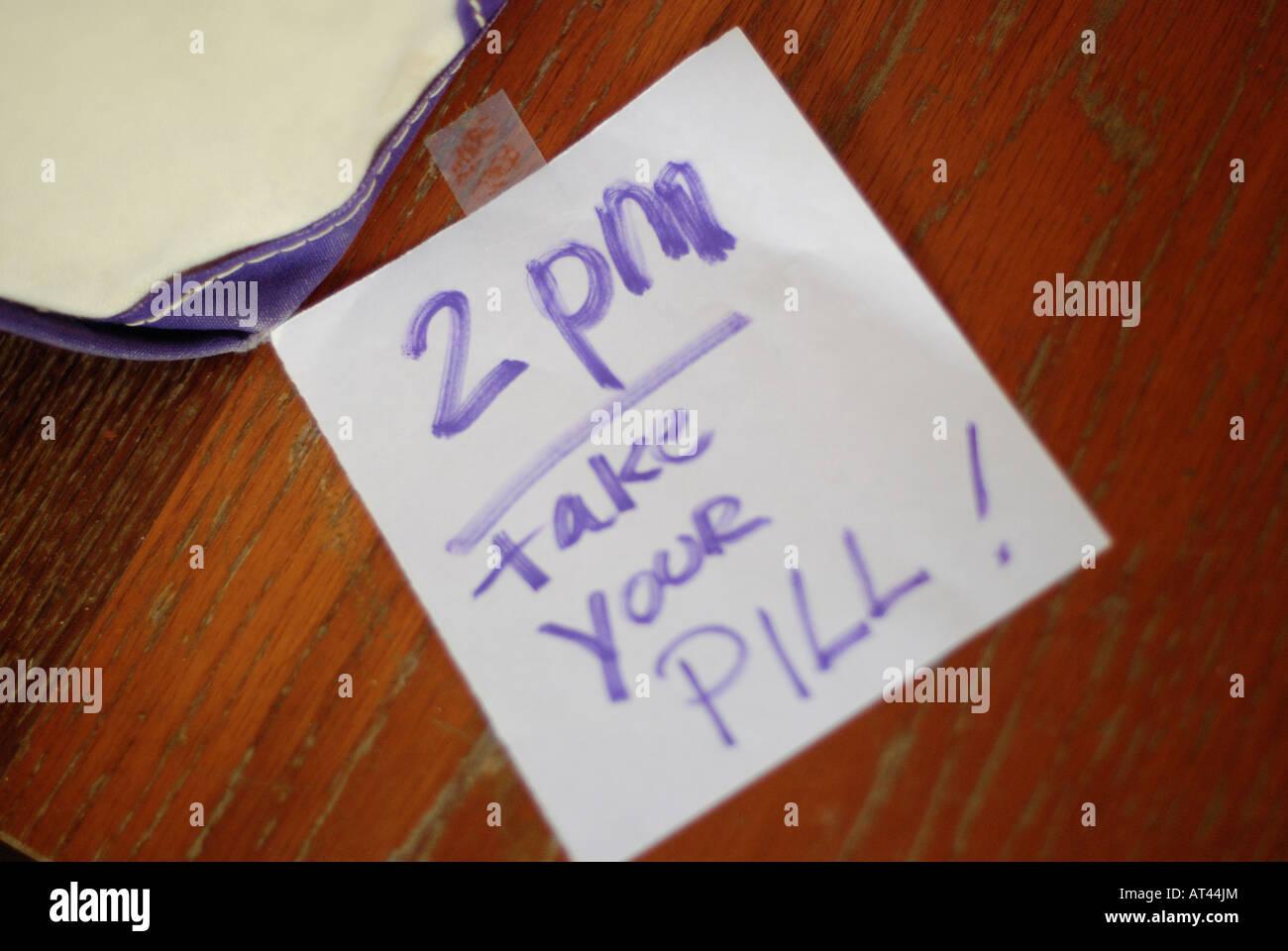 Sign reminding someone to take medication - Stock Image
