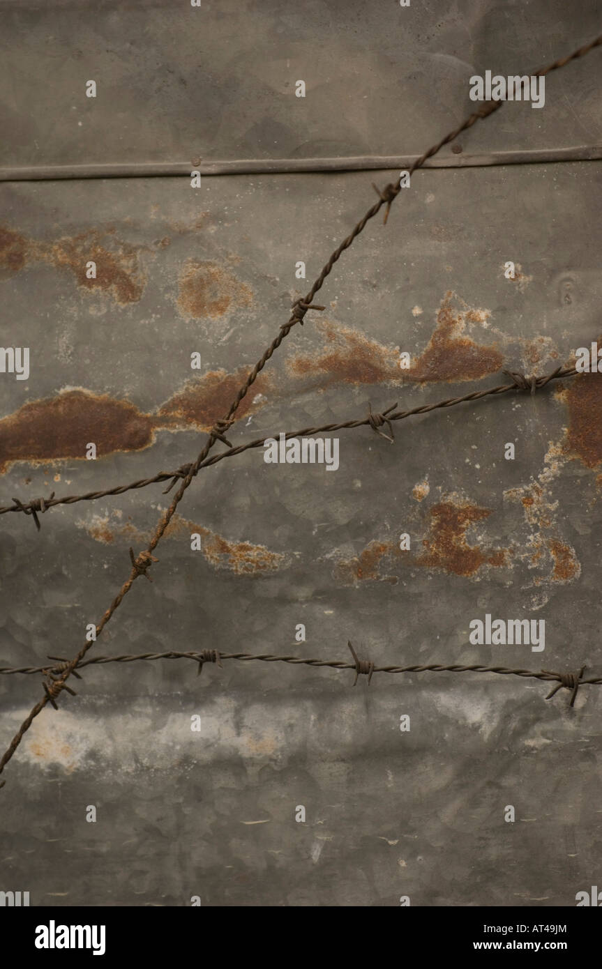 Barbed wire in front of rusting metal Chaing Mai Thailand - Stock Image