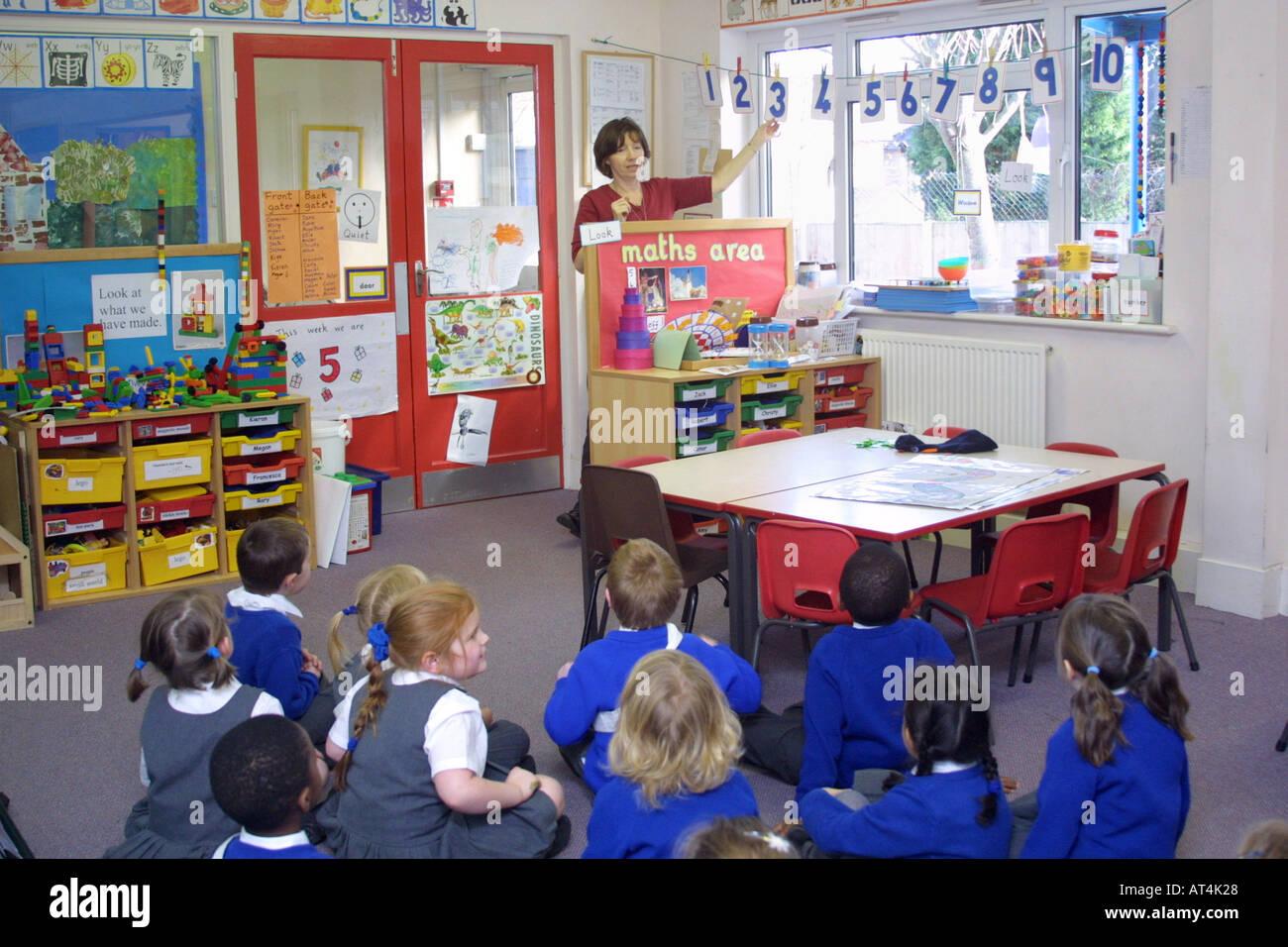 School classroom with teacher teaching reception children math Stock ...
