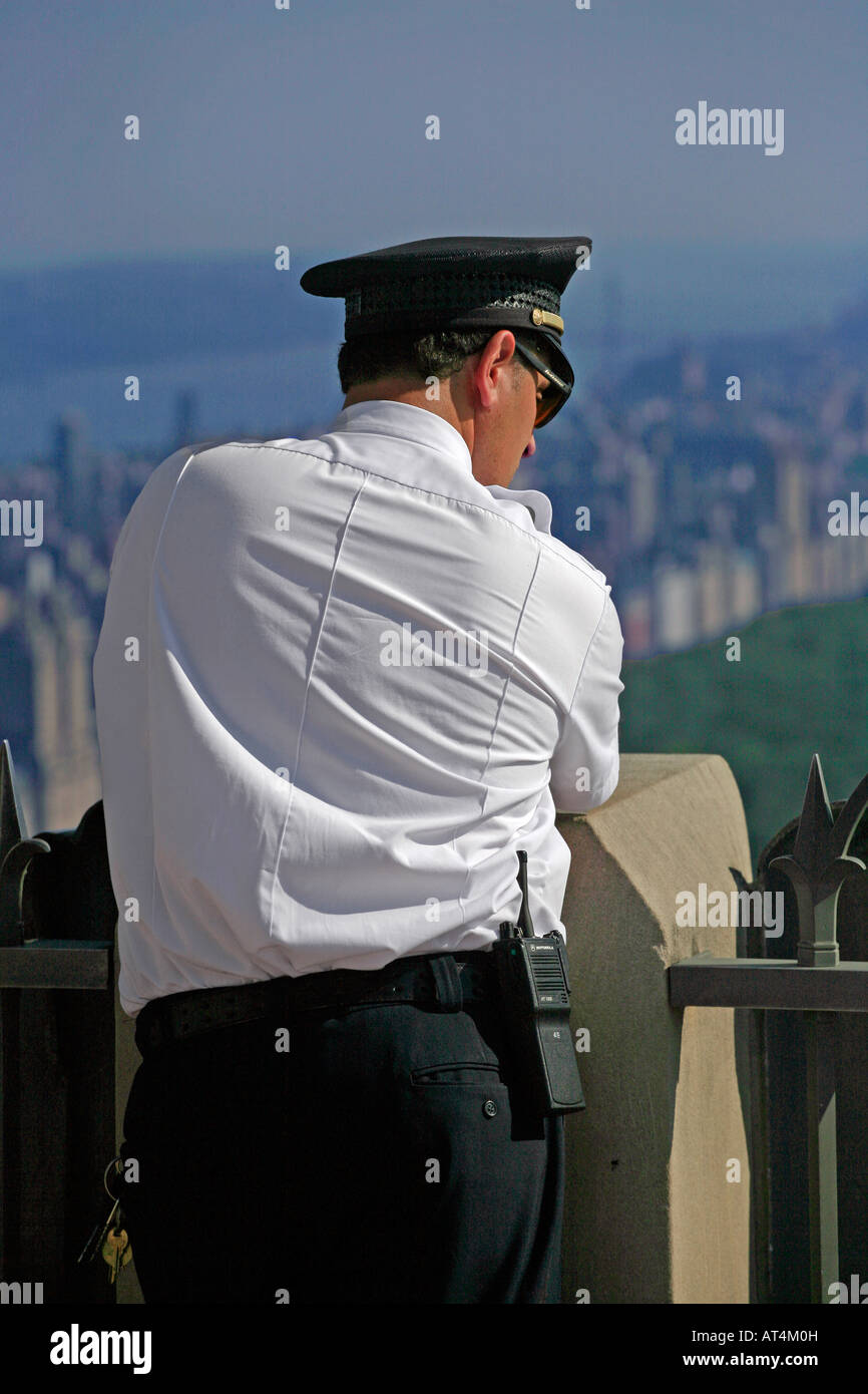 Security Guard admiring the view from TOP OF THE ROCK ROCKEFELLER CENTER NEW YORK CITY - Stock Image