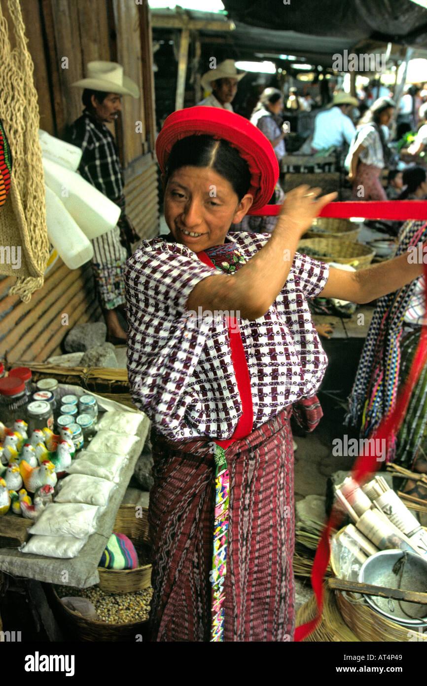 Guatemala Santiago Atitlan local woman winding her red hat - Stock Image