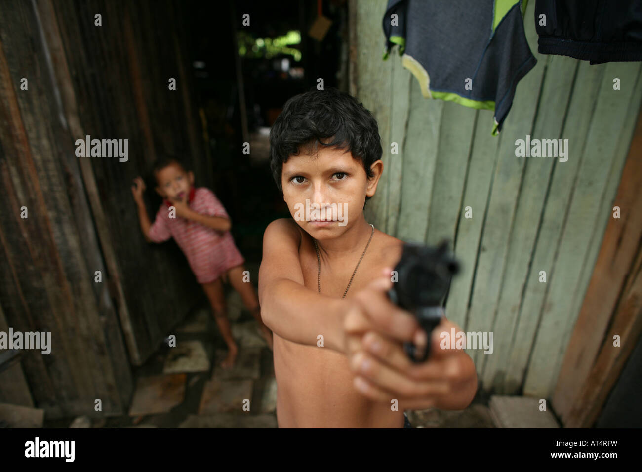 Children joining local gangs who become extremely violent Stock Photo