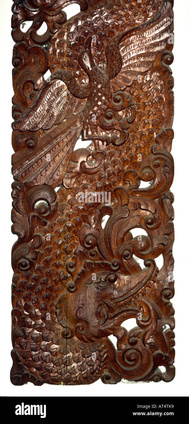 Indonesia java jepara crafts furniture carved wooden dragon panel stock image