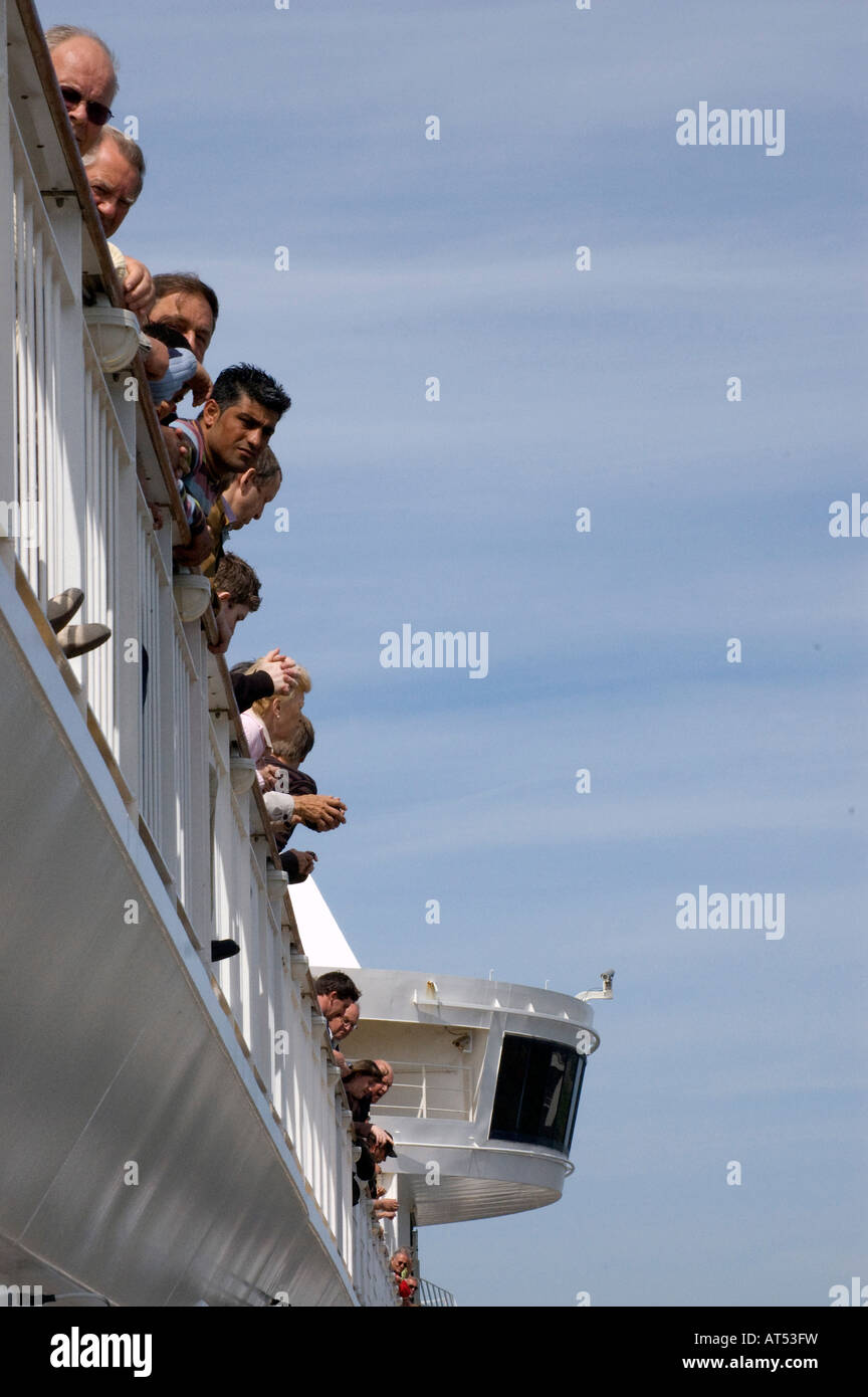 passengers on a ferry - Stock Image