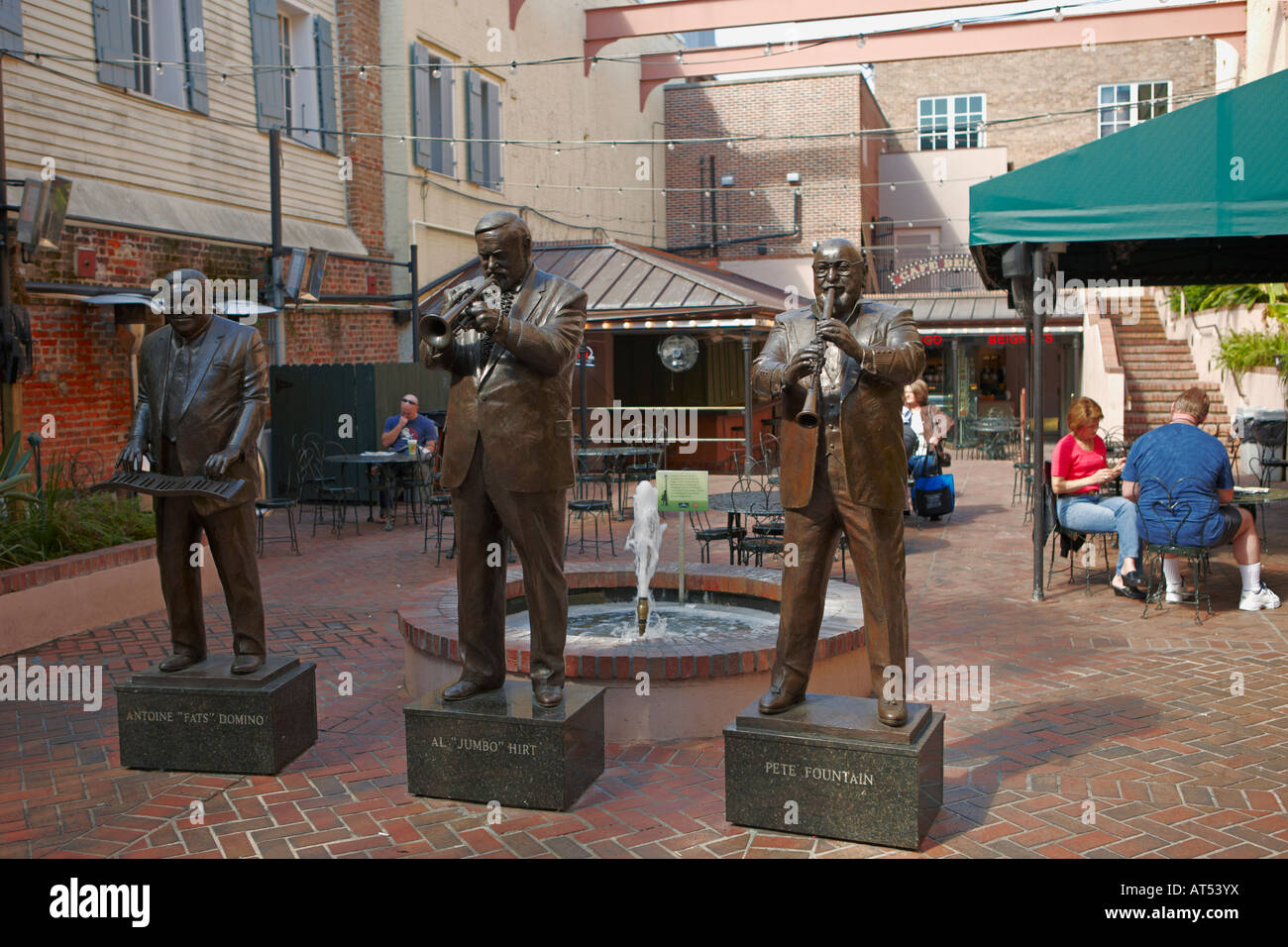 Bronze statues of famous jazz musicians - Antoine Domino, Al Hirt and Pete Fountain on Bourbon Street. French Quarter, - Stock Image
