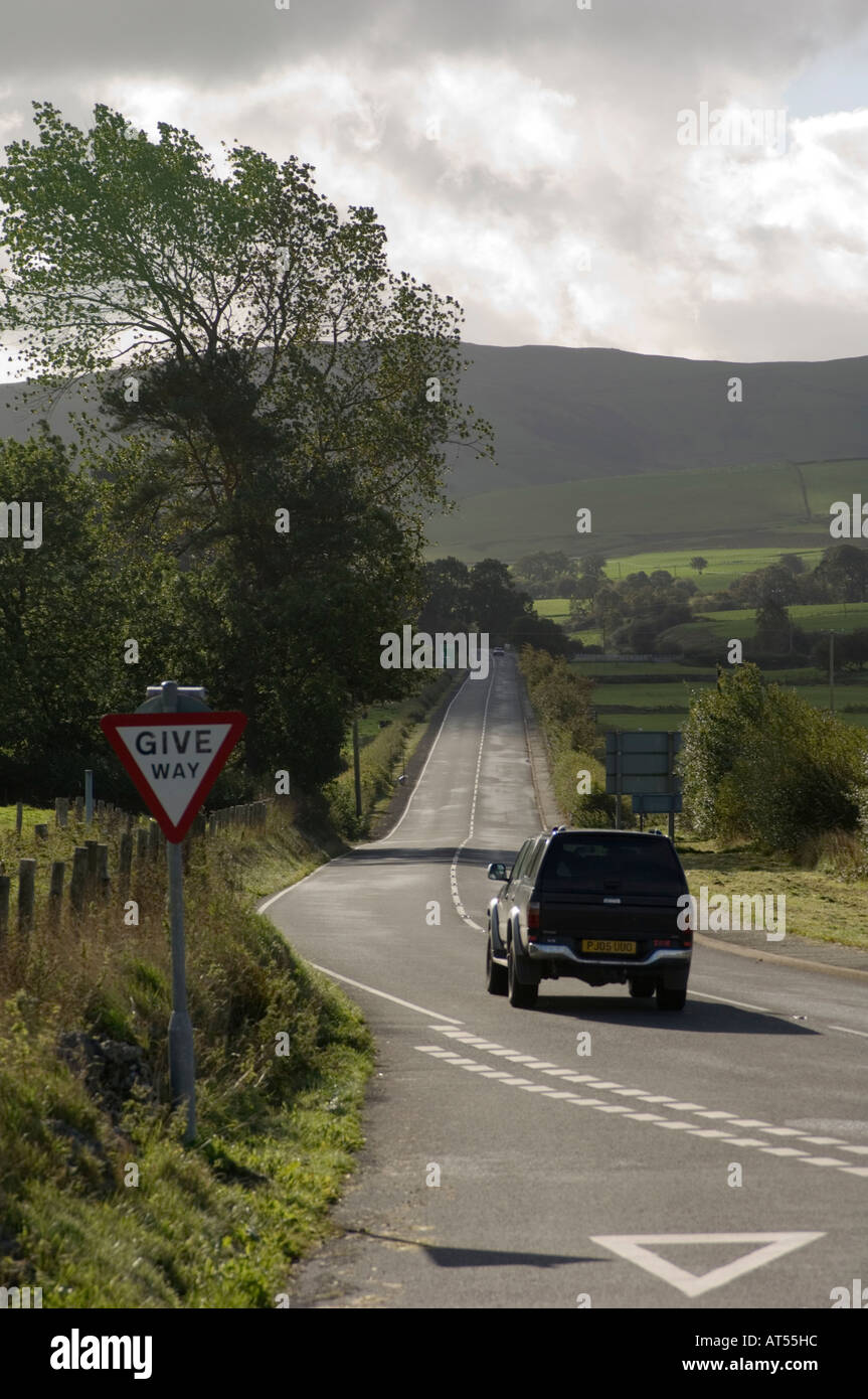 4x4 vehicle driving on  deserted A5 main road route to Holyhead near Cerrigydrudion north wales UK - Stock Image