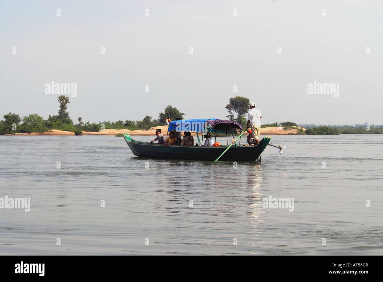 Dolphin watching long-tailed boat on Mekong River,Kratie,Cambodia - Stock Image